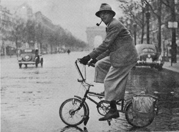 Jean-Paul Sarte riding a Le Petit Bi in Paris